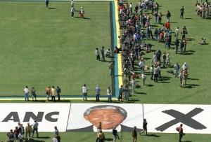 Graeme Williams, Portrait of Nelson Mandela painted on the grass of Soweto's largest football stadium during an election rally, 1994. Courtesy the artist. © Graeme Williams.