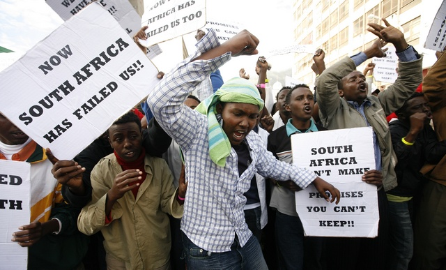 Somali nationals demonstrate outside the Parliament in Cape Town against recent xenophobic attacks